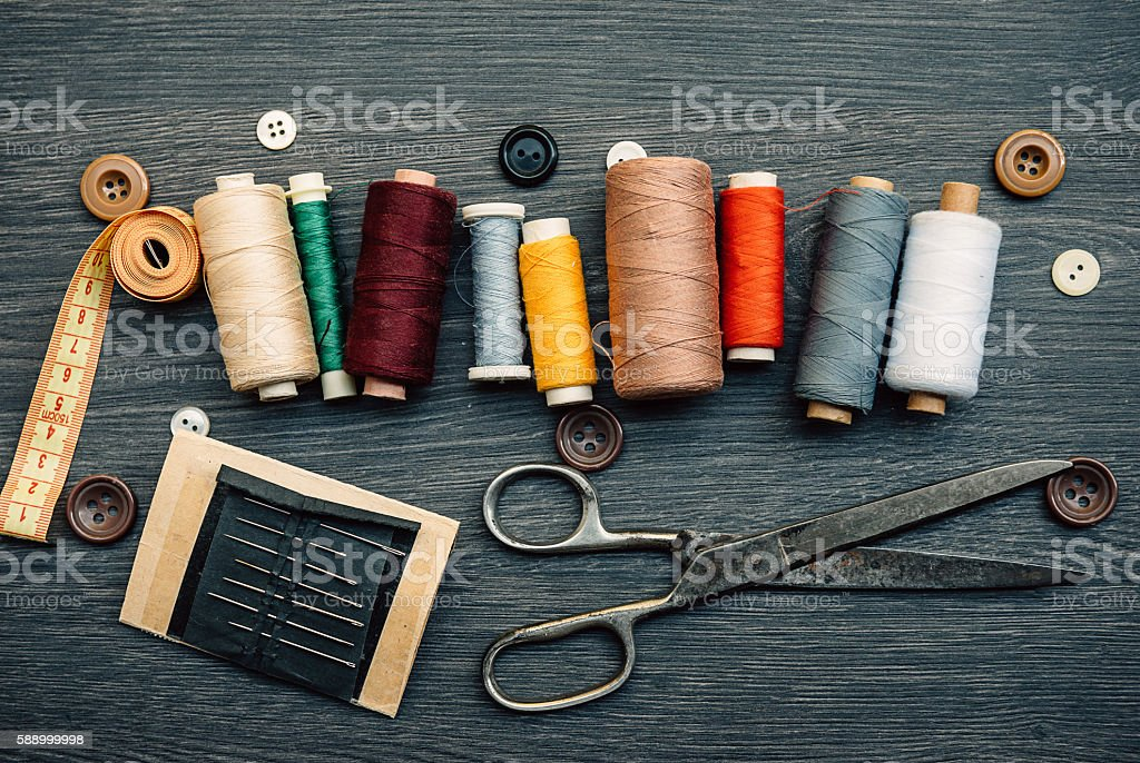 Selection of sewing threads in tailor shop stock photo