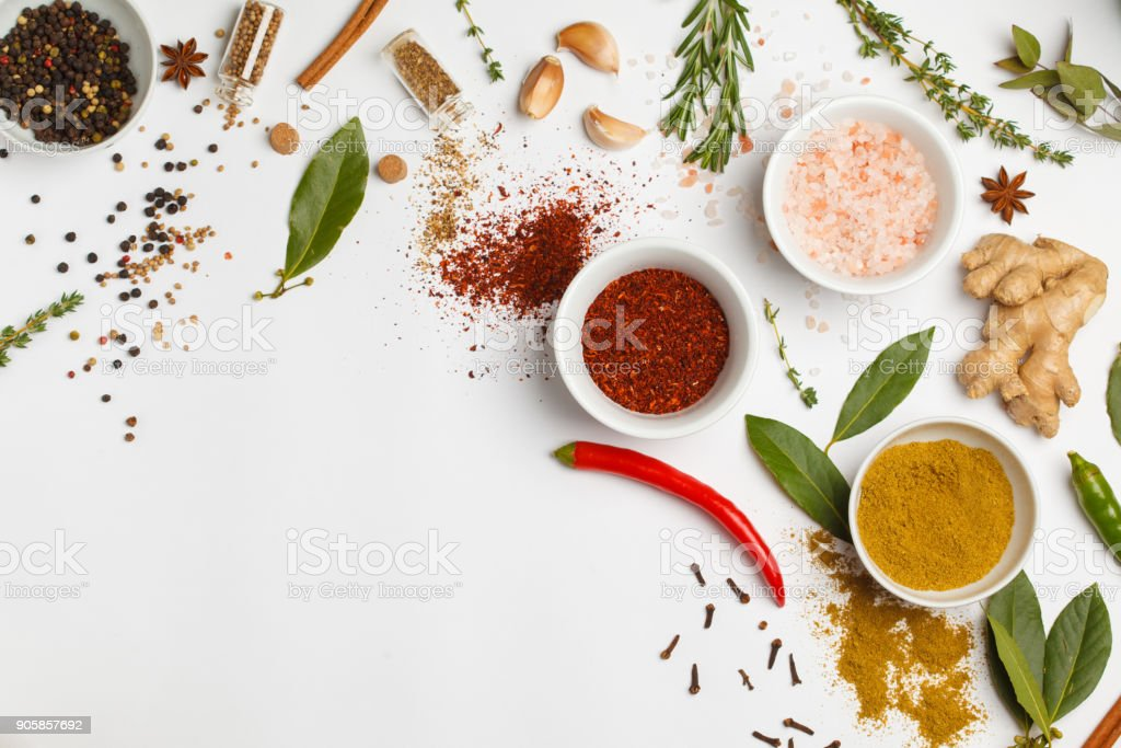 Selection of spices herbs and greens. Ingredients for cooking. White background, top view, copy space. stock photo