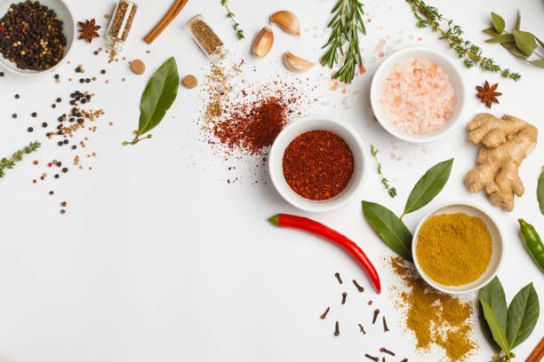 selection of spices herbs and greens. ingredients for cooking. white background, top view, copy space. - sól przyprawa zdjęcia i obrazy z banku zdjęć