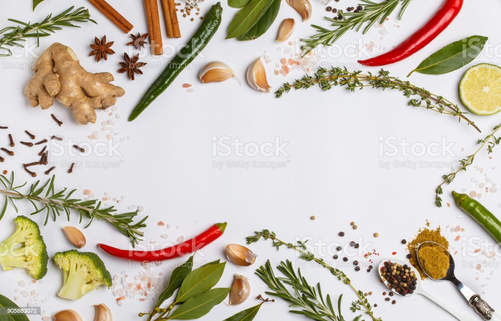 Selection of spices, herbs and greens. Ingredients for cooking. White background, top view, copy space. stock photo