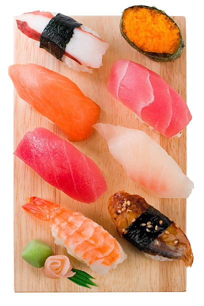 Selection of sushi and sashimi on a wooden board stock photo