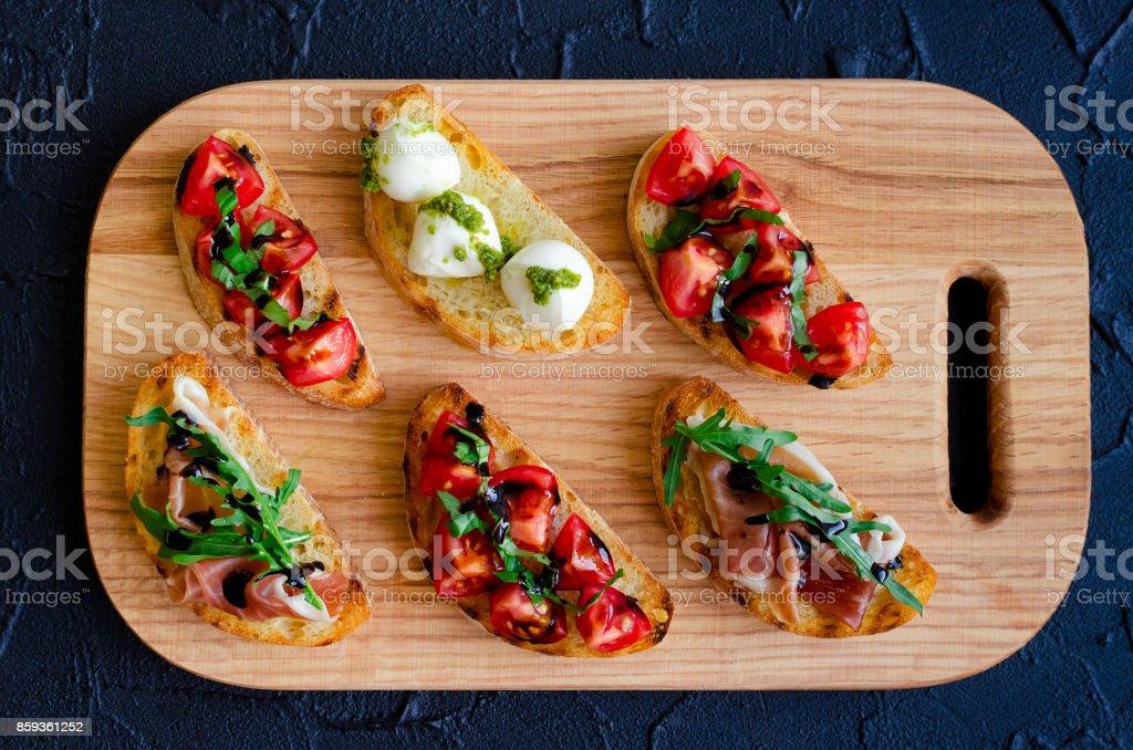 Selection of tasty bruschetta стоковое фото