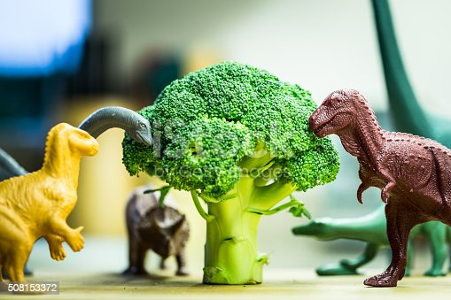 istock Selection of toy dinosaurs eating broccoli 508153372