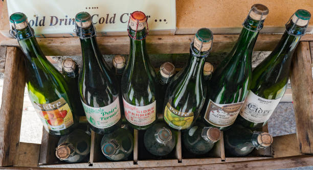 selection of typical Norman apple cider from the Calvados region Honfleur, Calvados / France - 15 August 2019: selection of typical Norman apple cider from the Calvados region calvados stock pictures, royalty-free photos & images