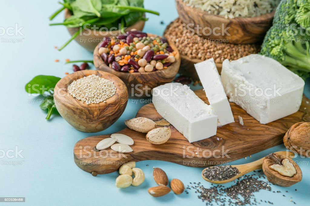 Selection of vegetarian protein sources - healthy diet concent Selection of vegetarian protein sources - healthy diet concent on bright blue background Almond Stock Photo