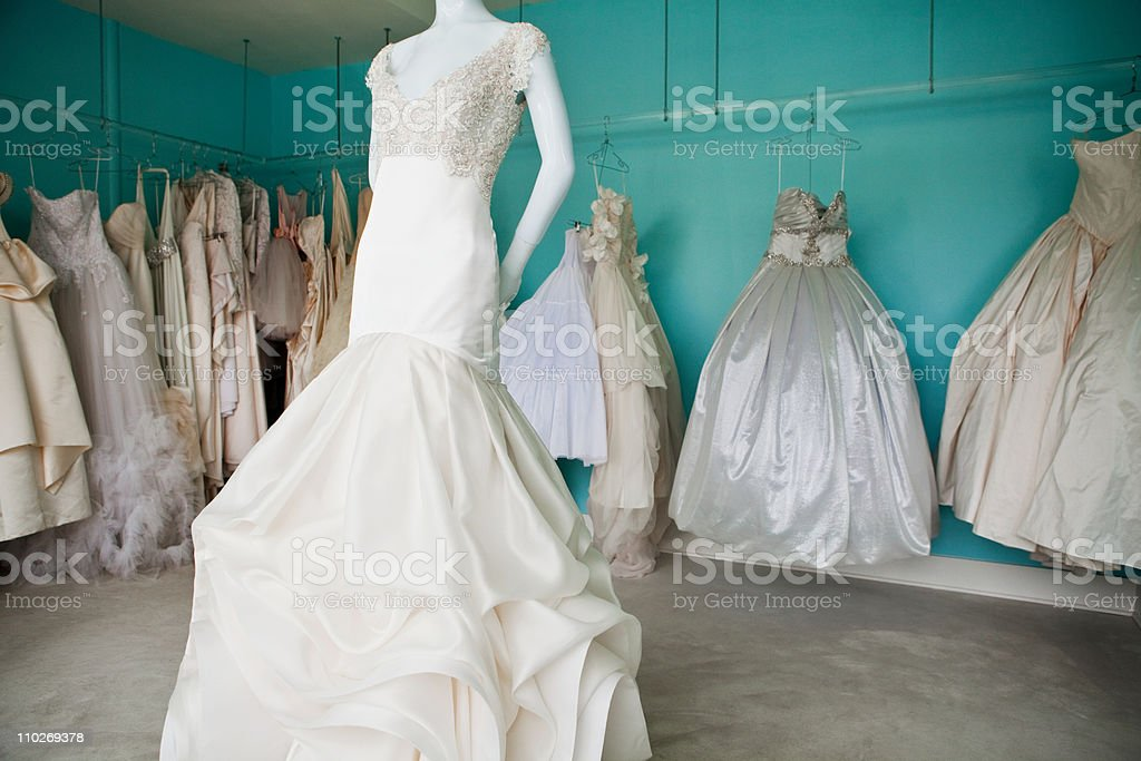 Selection of wedding dresses in boutique stock photo