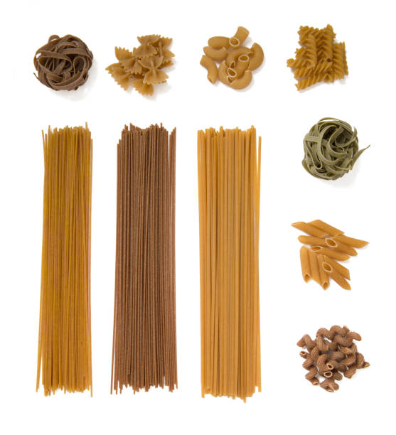 selection of whole grain pasta isolated on white background selection of whole grain pasta isolated on white background uncooked pasta stock pictures, royalty-free photos & images