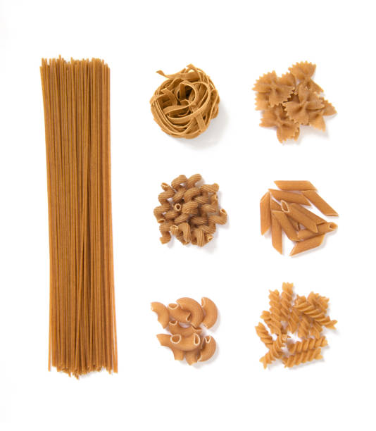 selection of whole grain pasta, isolated on white background: spaghetti, tagliatelle, farfalle, cellentani, penne, fussili selection of whole grain pasta, isolated on white background: spaghetti, tagliatelle, farfalle, cellentani, penne, fussili uncooked pasta stock pictures, royalty-free photos & images