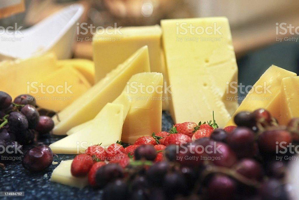 selection of yellow cheese and fruits royalty-free stock photo