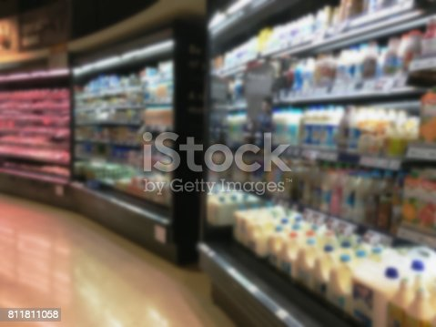922721264 istock photo Selection of yogurts, soy milk and milk on the shelves in a supermarket 811811058