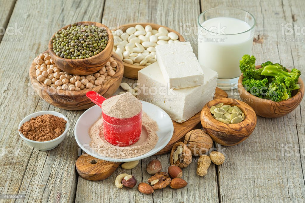 Selection vegan protein sources on wood background stock photo