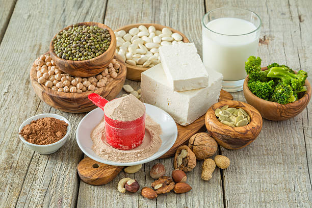 selection vegan protein sources on wood background - protein stock photos and pictures