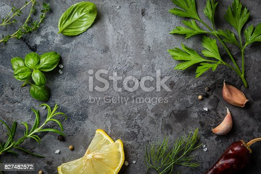 Selectionof herbs and spices on stone background, top view