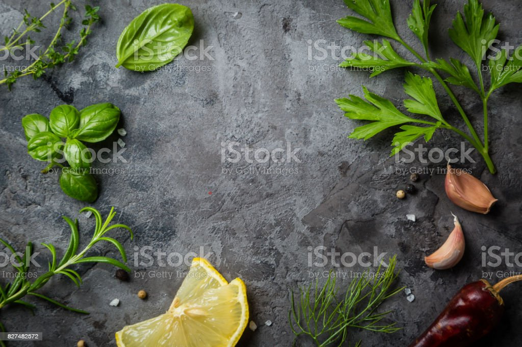 Selectionof herbs and spices on stone background stock photo