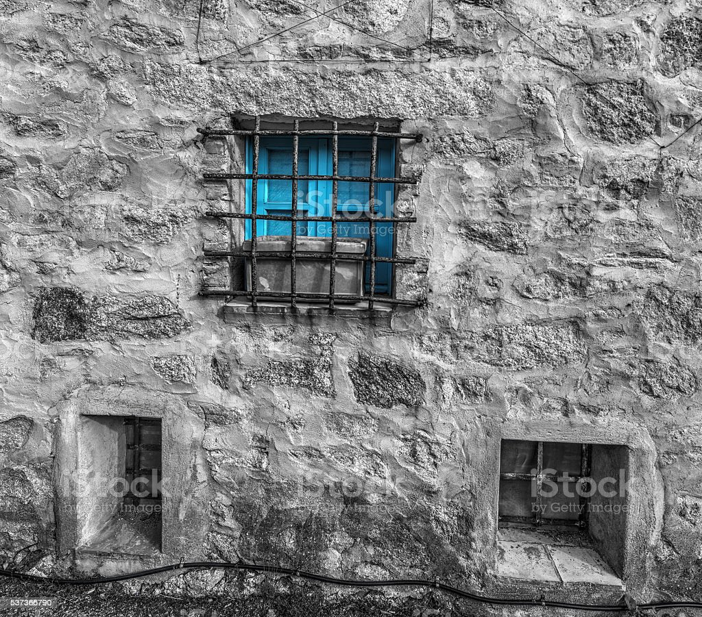 selective desaturation of a blue window stock photo