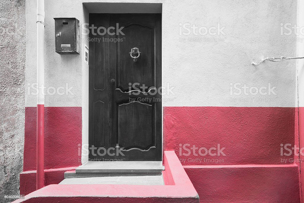 selective desaturation of a red wall stock photo