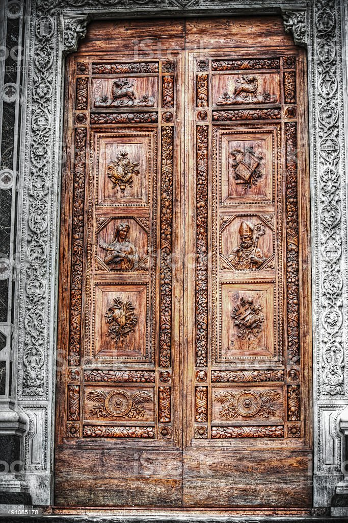 selective desaturation of Santa Croce front door stock photo
