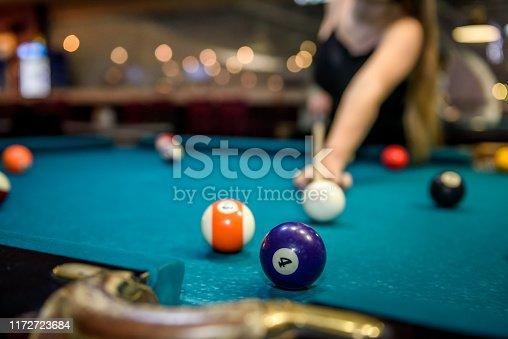 Selective focus at billiard ball on blue table