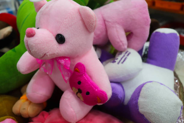 Selective Focus Beautiful Colorful Soft Toys For Gift And Present Selective Focus Beautiful Colorful Soft Toys For Gift And Present christmas teddy bear stock pictures, royalty-free photos & images
