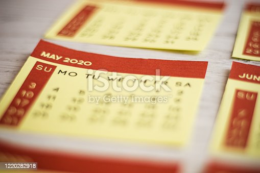 1162245415 istock photo Selective Focus Close-Up May 2020 Calendar Page On The Table 1220282918