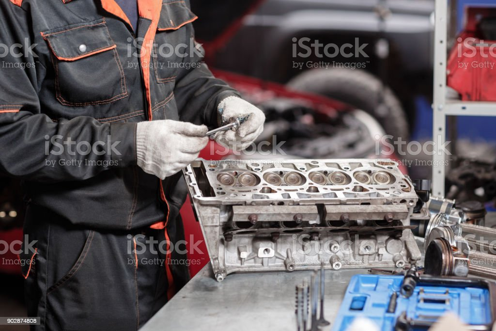 engine block on a repair stand with piston and connecting rod of automotive