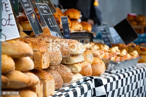 Selective focus, fresh sourdough breads on display at an outdoor food market around kings cross, London