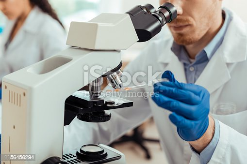istock Selective focus of a professional scientific microscope 1156456294