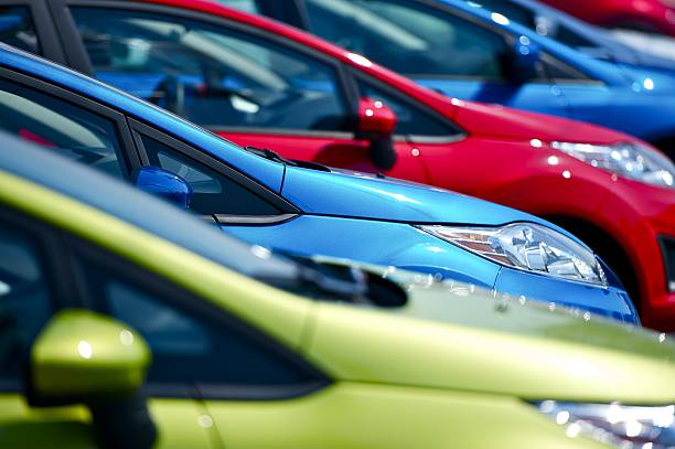 selective focus of cars at european dealership - stationary stock pictures, royalty-free photos & images
