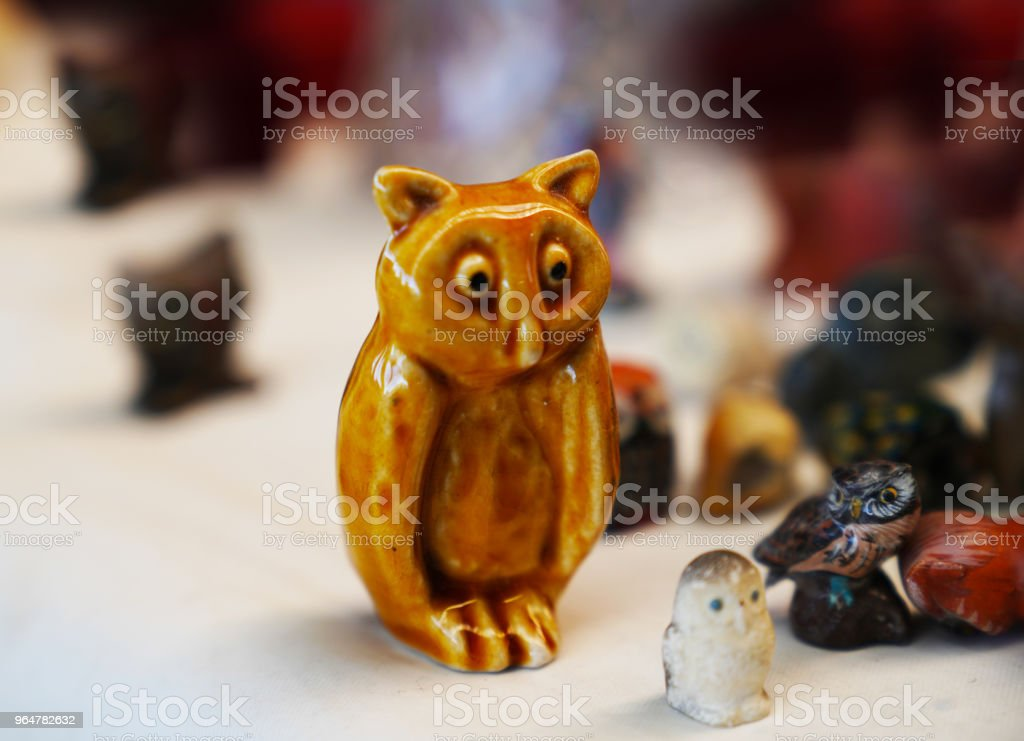 Selective focus of ceramic figurines of small owl royalty-free stock photo