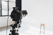 istock selective focus of digital camera on backstage in photo studio 1200700892