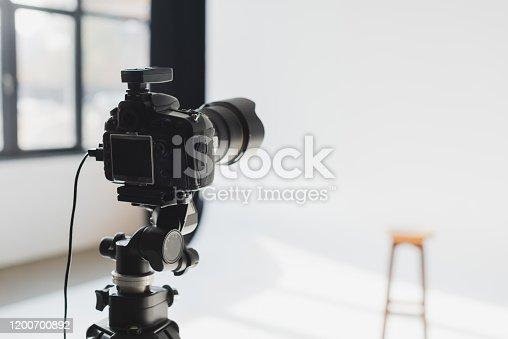 selective focus of digital camera on backstage in photo studio