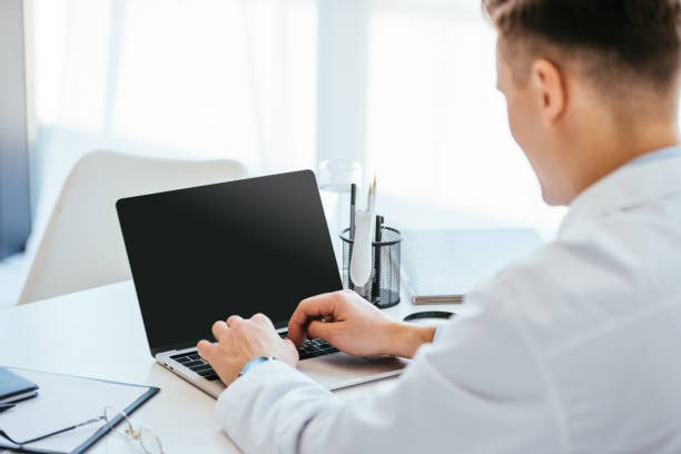 Selective focus of doctor using laptop with blank screen picture id1152216266?b=1&k=6&m=1152216266&s=612x612&w=0&h=vi aautw3j ry2nboy95fin mamdtbclphwpbkpm6pk=