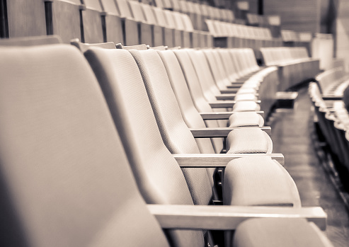 Selective focus of Empty rows of armchairs in hall