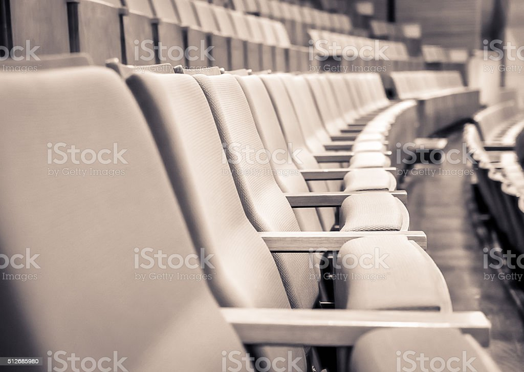 Selective focus of Empty rows of armchairs in hall stock photo