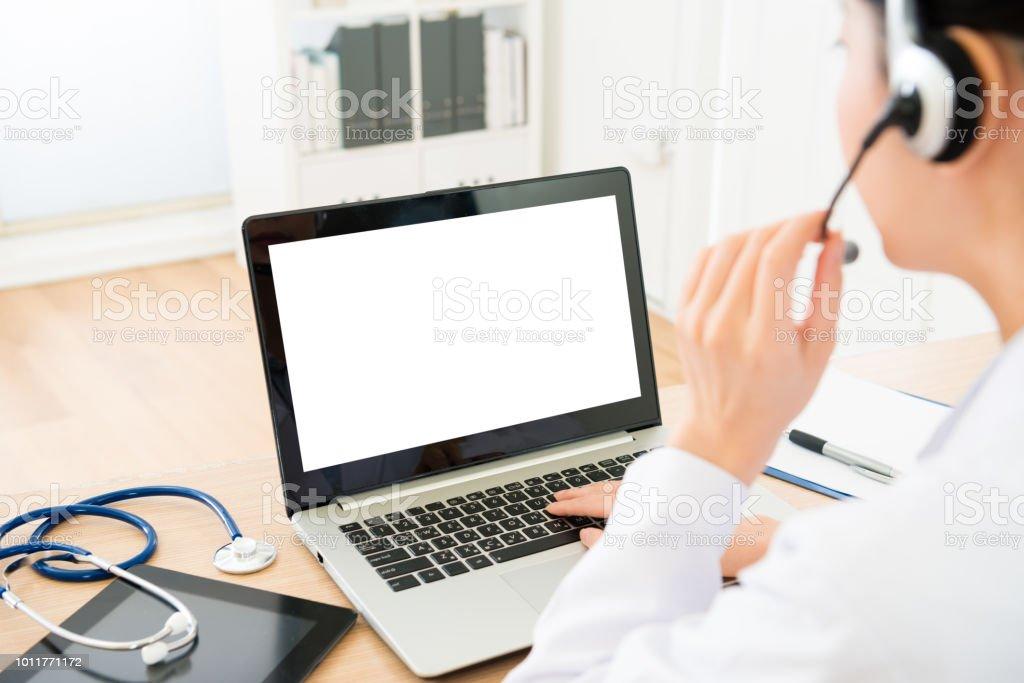 selective focus of female doctor wearing headphone