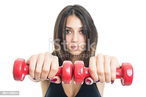 Selective Focus Of Girl Exercising With Two Dumbbells Stock Photo & More Pictures of Adult