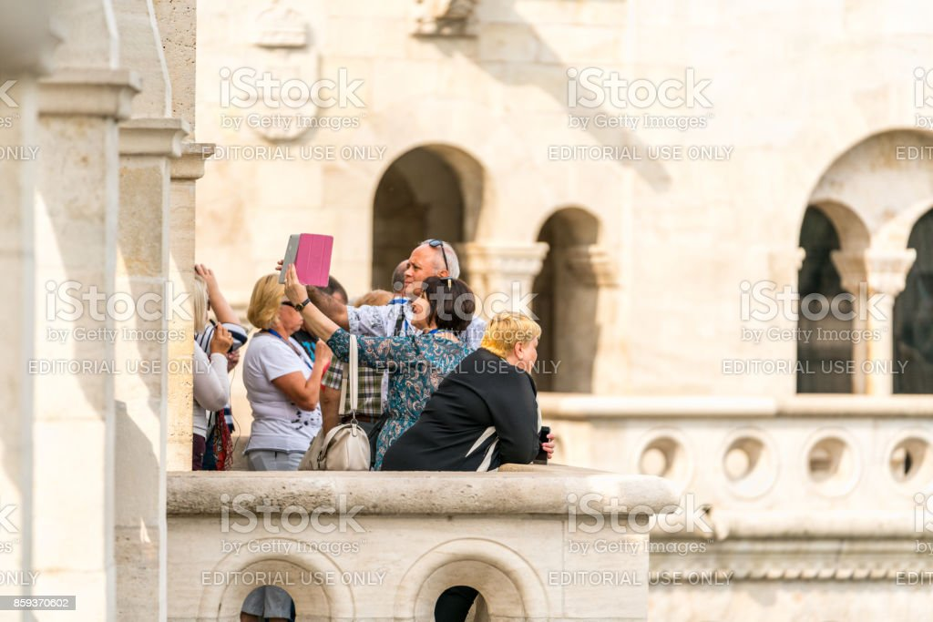 Selective focus of group of people taking pictures at a viewpoint in Budapest. royalty-free stock photo