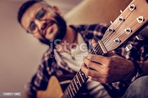 istock Selective focus of guitar strings being played on 1098011992