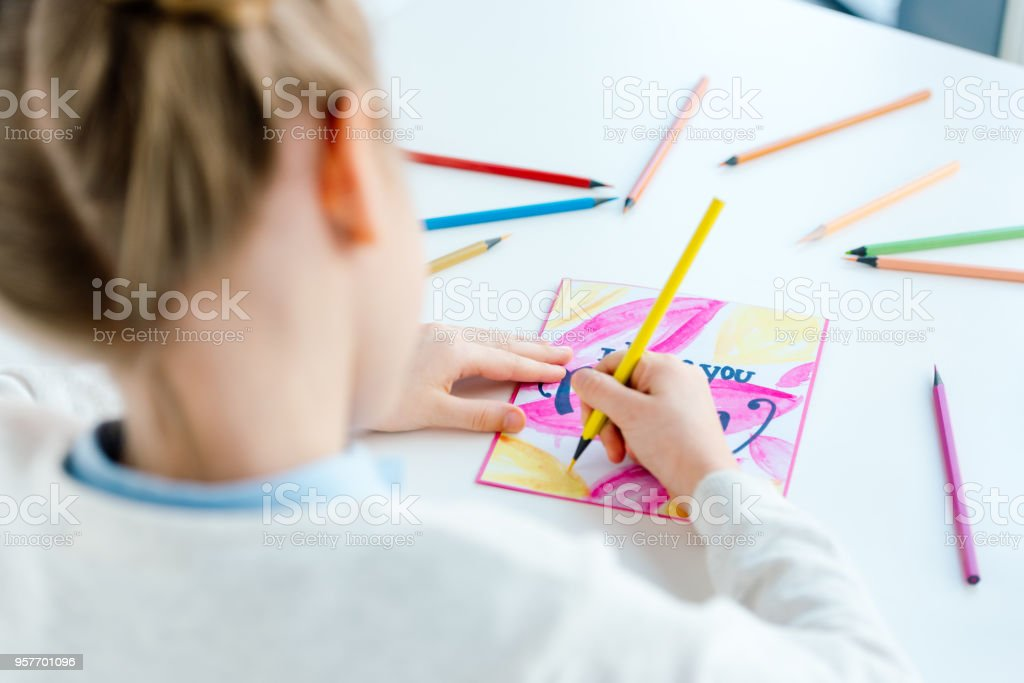 Selective Focus Of Kid Drawing Greeting Postcard For Mother With ...