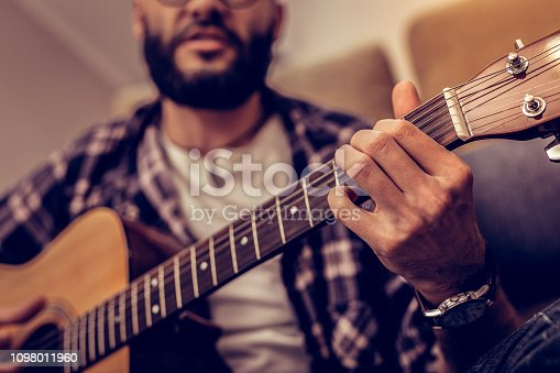 istock Selective focus of male fingers touching strings 1098011960