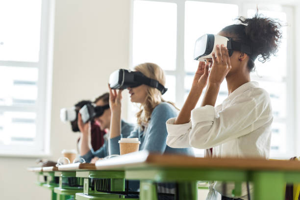 selective focus of multiethnic students using vr headsets in university - virtual reality stock pictures, royalty-free photos & images