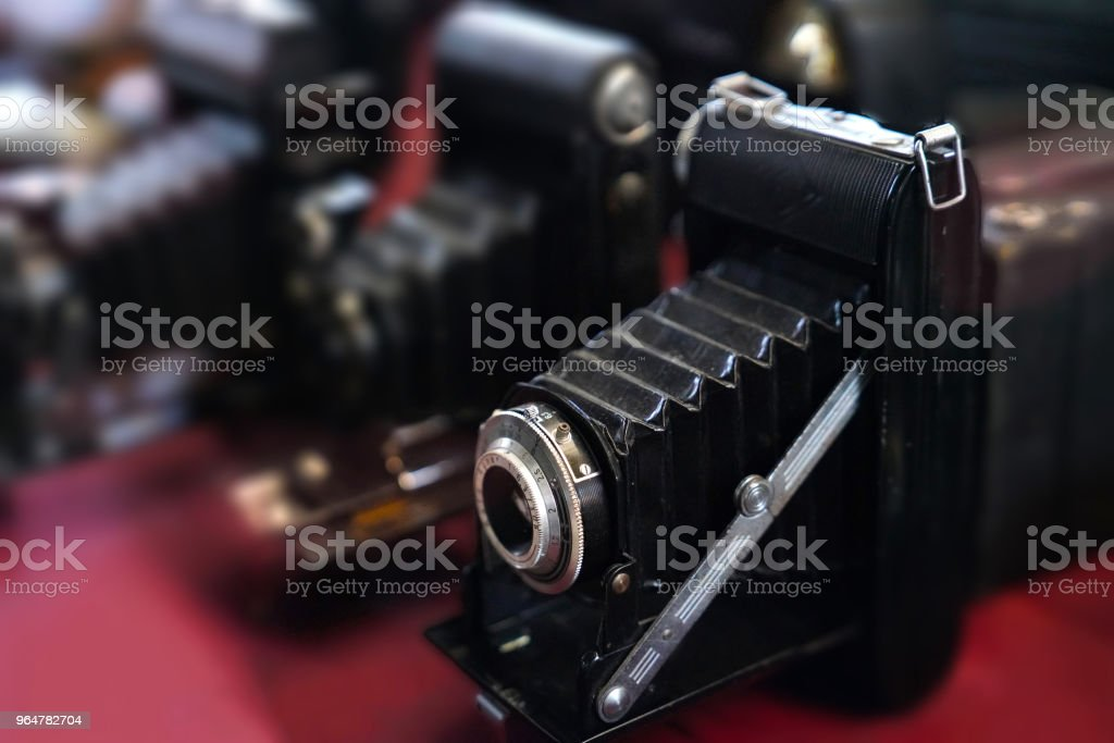 Selective focus of old bellow photography cameras royalty-free stock photo