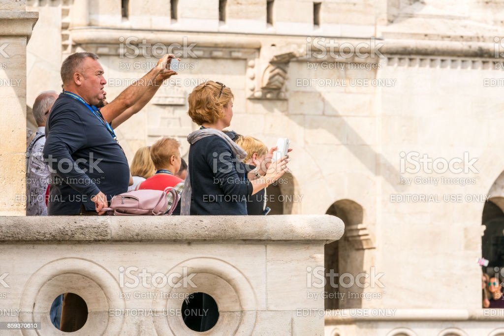 Selective focus of people at a viewpoint in Budapest looking at the city. royalty-free stock photo