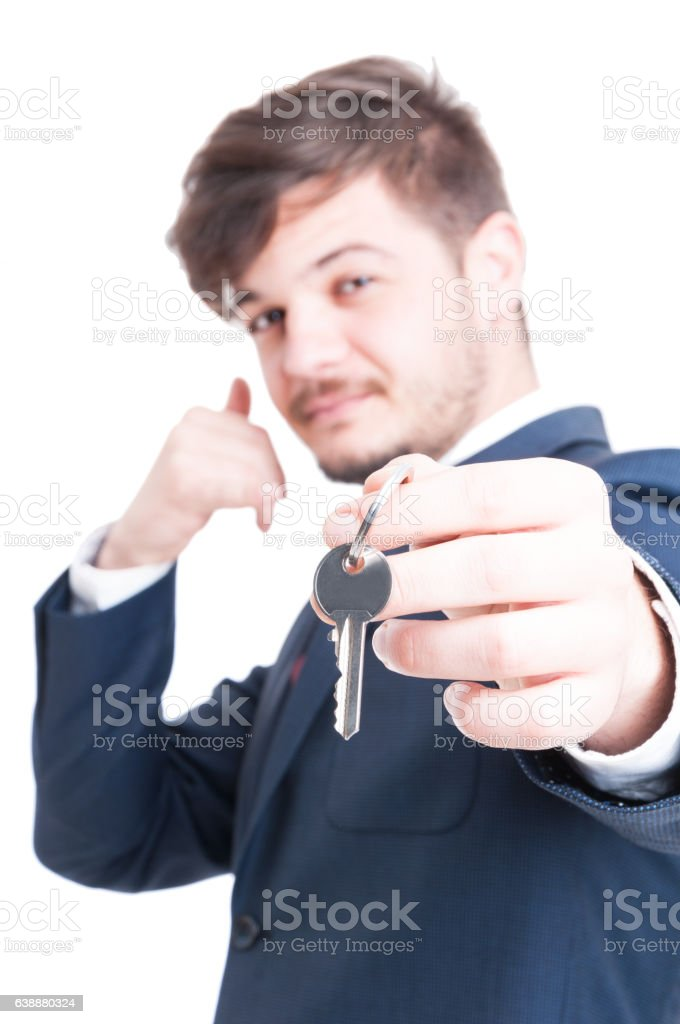 Selective focus of real estate agent showing keying and calling stock photo