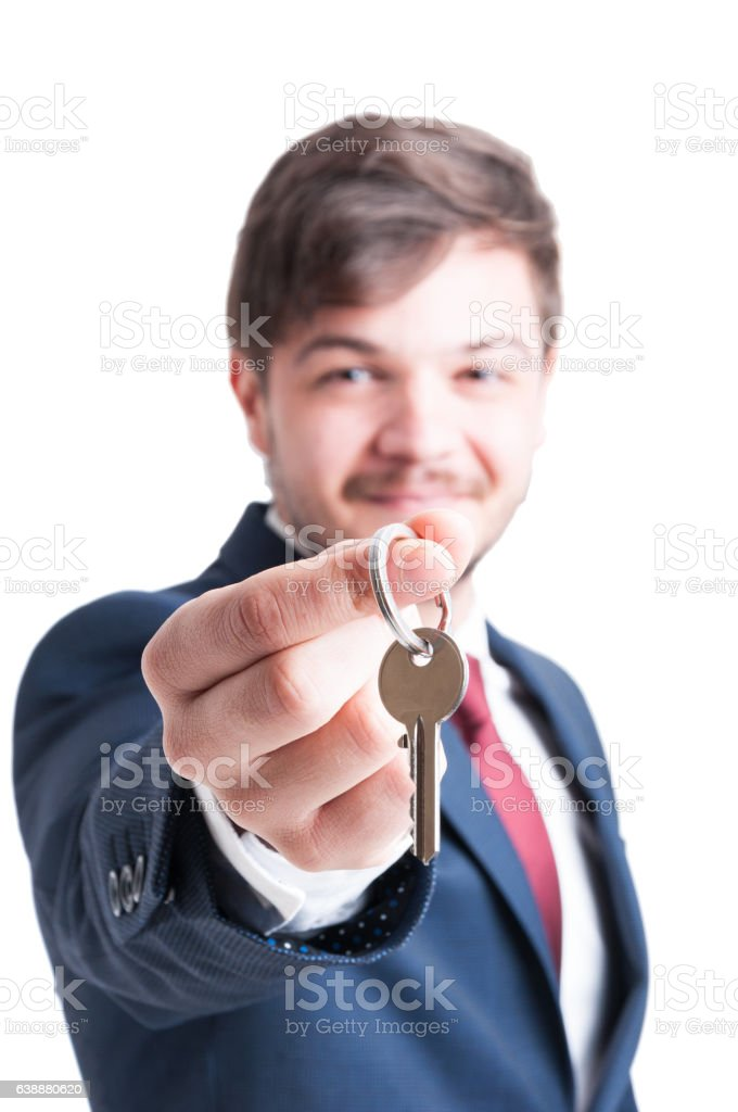 Selective focus of real estate agent showing keying stock photo