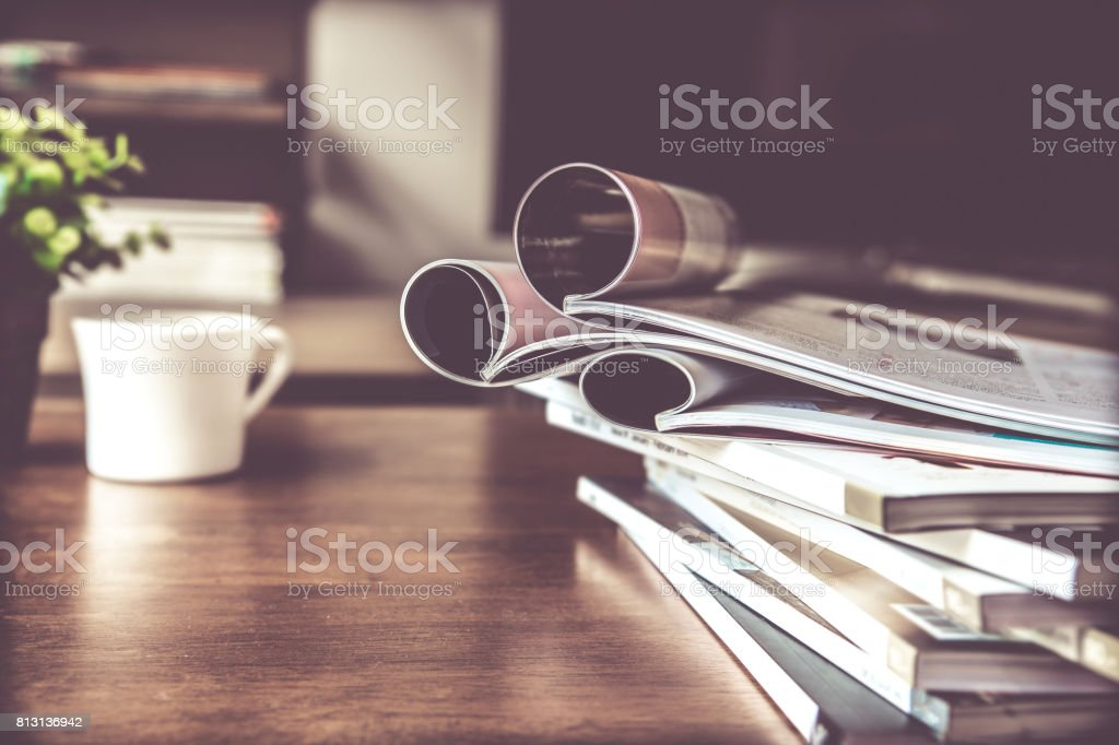selective focus of  stacking magazine place on table in living room stock photo