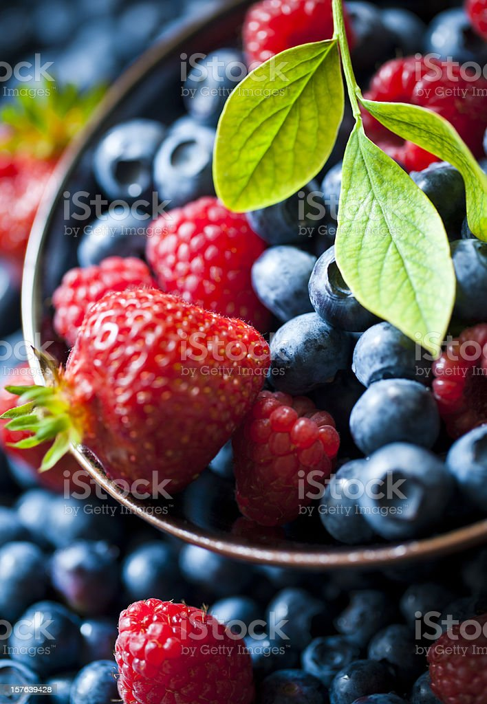 Selective focus of summer berries in bowl royalty-free stock photo