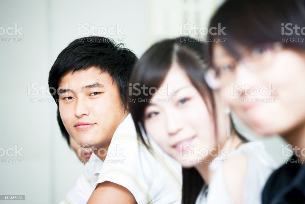 Selective focus of three Asian college friends royalty-free stock photo