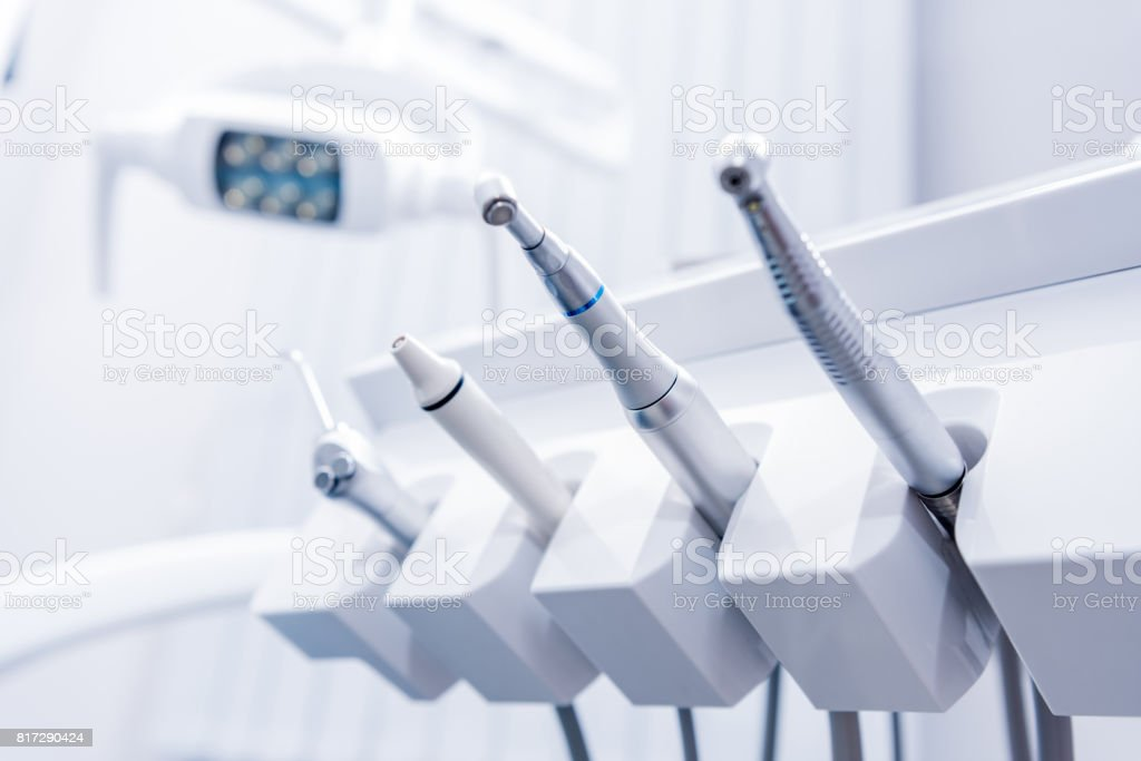 selective focus of various dental drills in dentist office stock photo