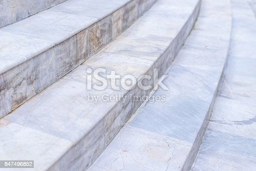Selective focus of white curve marble stairs, rounded step, architecture concept of exterior buildings. Background and texture usage.